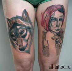 Тату на бедрах: волк и женщина